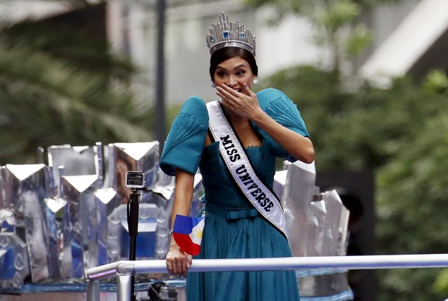 Miss Universe 2015 Pia Alonzo Wurtzbach reacts to a supporter wearing a makeshift crown and a Miss Universe sash (not pictured) during a motorcade in Manila, January 25, 2016. (Photo by Erik De Castro/Reuters)