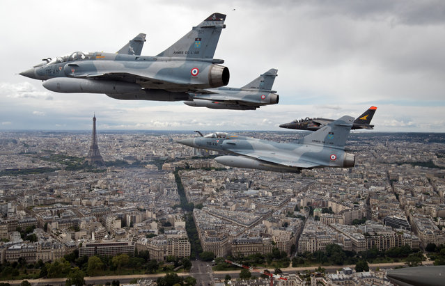 FRANCE: Four Mirage 2000C and one Alpha jet flight over Paris, France, on their way to participate in the Bastille Day military parade, July 14 2016. (Photo by Philippe Wojazer/Reuters)