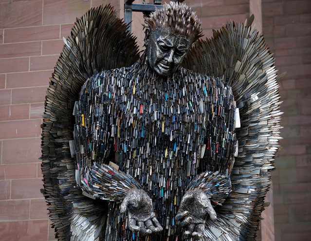 """The """"Angel of Knives"""" sculpture by artist Alfie Bradley, made from over 100,000 confiscated knives, goes on display outside the Anglican Cathedral, in Liverpool, Britain, November 29, 2018. (Photo by Phil Noble/Reuters)"""