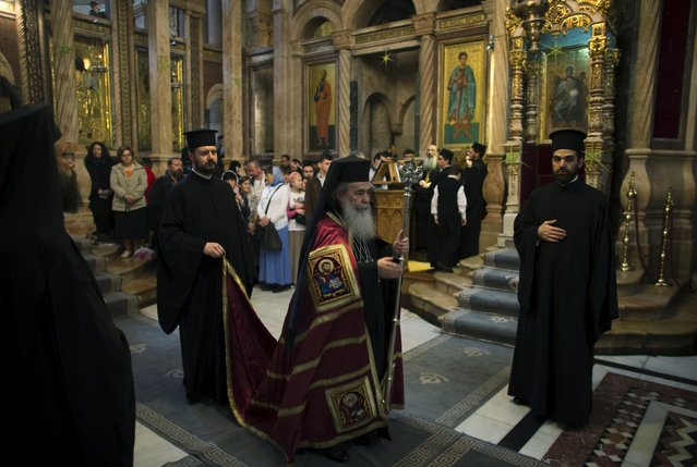 Greek Orthodox Patriarch of Jerusalem Metropolitan Theophilos (C) walks through the Church of the Holy Sepulchre in Jerusalem's Old City on Palm Sunday April 5, 2015. (Photo by Ronen Zvulun/Reuters)
