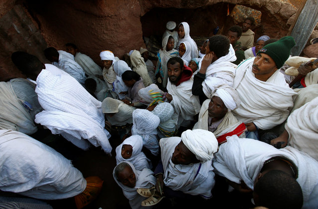 Ethiopian Orthodox faithful attend a morning prayer at a rock hewn church ahead of Ethiopian Christmas in Lalibela, January 6, 2017, which is celebrated on January 7. (Photo by Tiksa Negeri/Reuters)