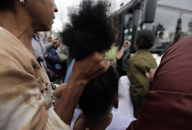 Security forces drag members of the Ladies in White, a group made up of family members of imprisoned dissidents, into a bus after a march in Havana, Cuba, March 2010. (Photo by Desmond Boylan/Reuters)