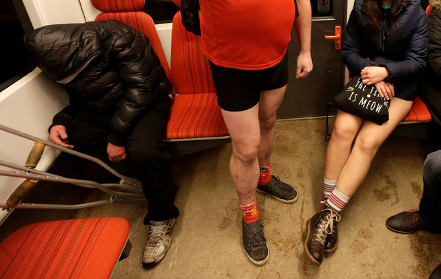 "Passengers not wearing pants go by a subway train during the ""No Pants Subway Ride"" in Prague, Czech Republic, January 8, 2017. (Photo by David W. Cerny/Reuters)"