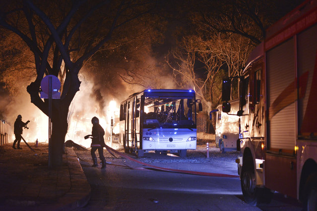 Firefighters work at a scene of fire from an explosion in Ankara, Wednesday, February 17, 2016. A large explosion, believed to have been caused by a bomb, injured several people in the Turkish capital on Wednesday, according to media reports. Private NTV said the explosion occurred during rush hour in an area close to where military headquarters are located as a bus carrying military personnel was passing by. (Photo by IHA via AP Photo)