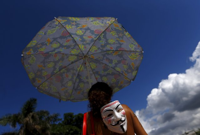 A demonstrator protests against the construction of Rio 2016 Olympic Golf venue in Rio de Janeiro March 25, 2015. (Photo by Ricardo Moraes/Reuters)