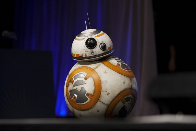 A robot character crosses the stage at the kick-off event of the Star Wars celebration convention in Anaheim, California, April 16, 2015. (Photo by David McNew/Reuters)