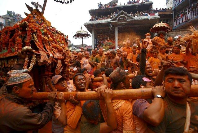 Devotees celebrate Sindoor Jatra vermillion powder festival at Thimi, in Bhaktapur April 15, 2015. (Photo by Navesh Chitrakar/Reuters)
