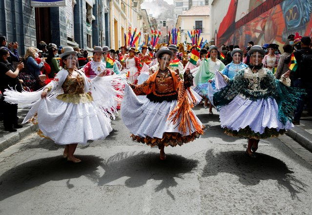 Dancers perform during the Morenada dance national day in La Paz, Bolivia, September 7, 2021. (Photo by Manuel Claure/Reuters)