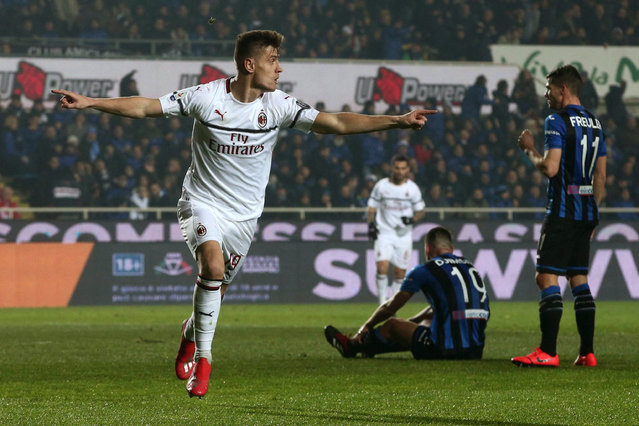Milan forwarder Krzysztof Piatek celebrates after scoring during the Serie A soccer match between Atlanta and AC Milan at the Azzurri d'Italia Stadium in Bergamo, Italy, Saturday, February 16, 2019. (Photo by Paolo Magni/ANSA via AP Photo)