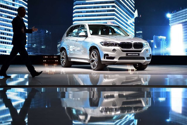 A BMW X5 xDrive 40e is displayed during a presentation at the 16th Shanghai International Automobile Industry Exhibition in Shanghai on April 20, 2015. (Photo by Johannes Eisele/Getty Images)