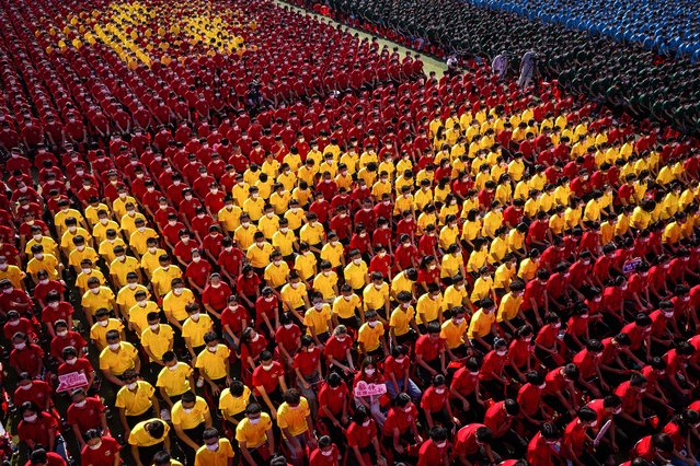 University students form an image to mark the 100th anniversary of the founding of the Communist Party of China during an opening ceremony of the new semester in Wuhan in China's central Hubei province on September 10, 2021. (Photo by AFP Photo/China Stringer Network)