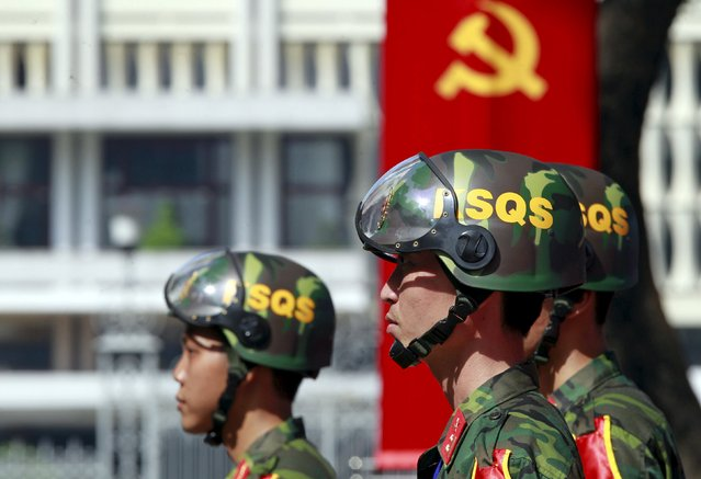 Members of a military patrol keep guard in front of the Reunification Palace, formerly the  presidential palace, during a rehearsal for a military parade as part of the 40th anniversary of the fall of Saigon, in southern Ho Chi Minh City (formerly Saigon City), Vietnam, April 26, 2015. (Photo by Reuters/Kham)