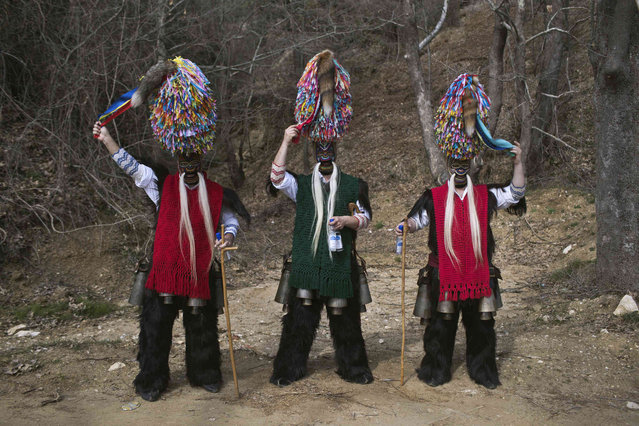 In this Monday March 11, 2019 photo, men wearing goat hides with bells around their waist and masks that include a meter tall, ribbon-covered formation topped with a foxtail, also known as bell wearers, pose for a photo at the village of Sohos, northern Greece as they participate in a Clean Monday festival. Greek carnivals at this time of year can be modest but they showcase ancient rites and traditions as well as providing reminders to some bloody moments in the country's modern history. In northern Greece, two of the most celebrated carnival customs are found in the mountain town of Sochos, and in Naoussa. (Photo by Petros Giannakouris/AP Photo)