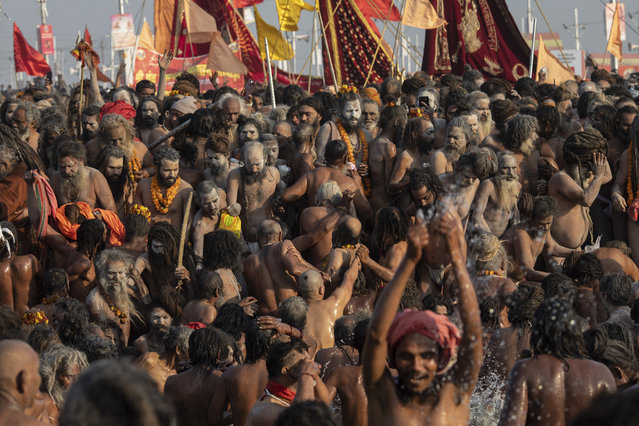 In this Tuesday, January 15, 2019 photo, sadhus, Hindu holy men, take a holy dip at Sangam, the confluence of the rivers Ganges, Yamuna and mythical Saraswati, during the Kumbh Mela festival in Prayagraj, India. The city's Mughal-era name Allahabad was recently changed to Prayagraj by the Hindu nationalist government. The historic city name referred to Muslim Mughal rulers during the 16th century. The new name refers to the confluence of the rivers Ganges, Yamuna and mythical Saraswati, the site of the Hindu Kumbh Mela festival. (Photo by Bernat Armangue/AP Photo)