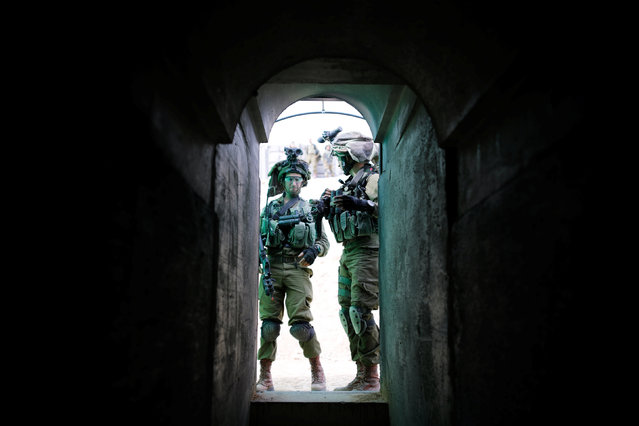 Israeli soldiers from the Nahal Infantry Brigade stand at an opening of an underground tunnel during an urban warfare drill at an army base near Arad, southern Israel February 8, 2017. (Photo by Amir Cohen/Reuters)