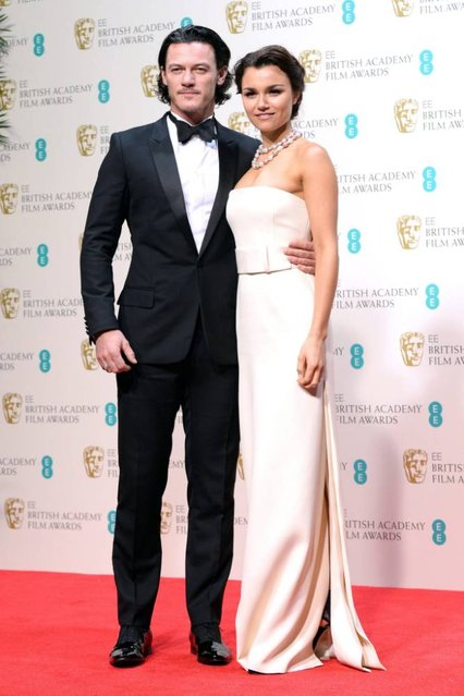 """British actress Samantha Barks and actor Luke Evans  pose in the press room after presenting the British Short Film in 2014 award for """"Room 8"""" at the 2014 EE British Academy Film Awards ceremony at The Royal Opera House in London, Britain, 16 February 2014. (Photo by Andy Rain/EPA)"""