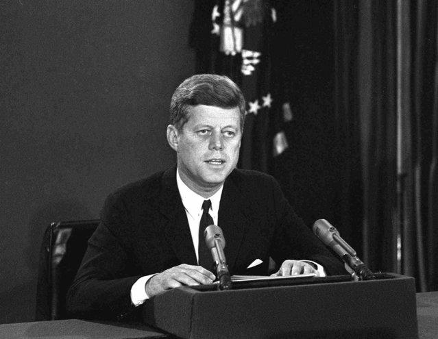 President John F. Kennedy makes a national television speech October 22, 1962, from Washington.  He announced a  naval blockade of Cuba until Soviet missiles are removed. (Photo by AP Photo)