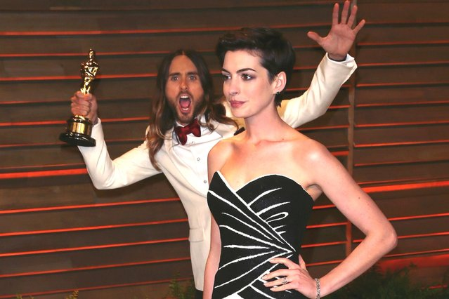 Jared Leto and his Oscar photobombs actress Anne Hathaway at the 2014 Vanity Fair Oscar Party. (Photo by David Livingston/Getty Images)
