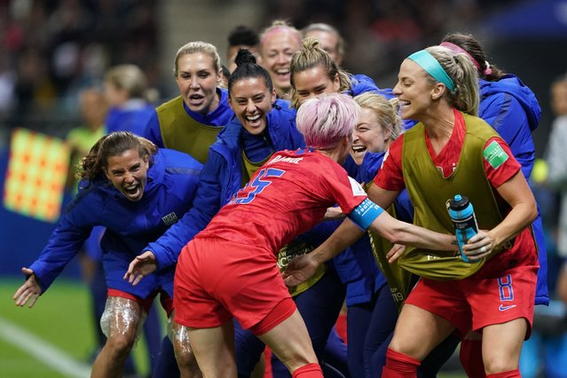 United States' forward Megan Rapinoe celebrates with teammates after scoring a goal during the France 2019 Women's World Cup Group F football match between USA and Thailand, on June 11, 2019, at the Auguste-Delaune Stadium in Reims, eastern France. (Photo by Lionel Bonaventure/AFP Photo)