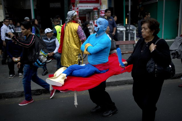 A clown marches while commemorating the Peruvian clown day in Lima Peru, Monday, May 25, 2015. (Photo by Rodrigo Abd/AP Photo)