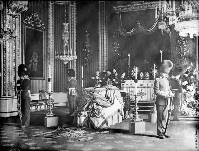 1910: Guards surround the coffin at the private lying in state of King Edward VII at Buckingham Palace, London