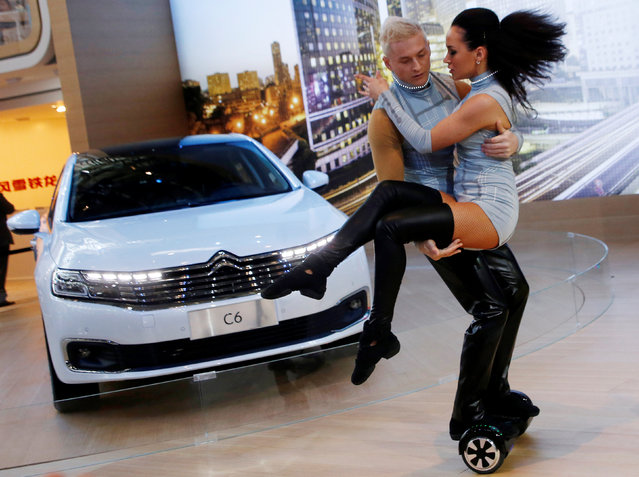 Dancers on a personal mobility device perform in front of Citroen's C6 sedan during the Auto China 2016 show in Beijing, China April 26, 2016. (Photo by Kim Kyung-Hoon/Reuters)