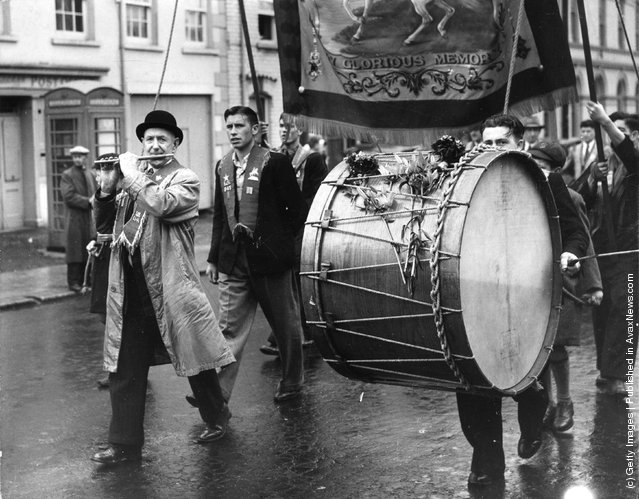 1951: A flautist and lambeg drummer marching with their Orange Lodge in Belfast, Northern Ireland, to celebrate the victory of William III over James II in 1690 and  to re-affirm their loyalty to the king and empire