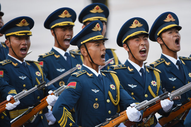 Members of a military honour guard parade during  a welcome ceremony for Uzbekistan's Prime Minister Abdulla Aripov (not seen) outside the Great Hall of the People in Beijing on August 27, 2019. (Photo by Greg Baker/AFP Photo)