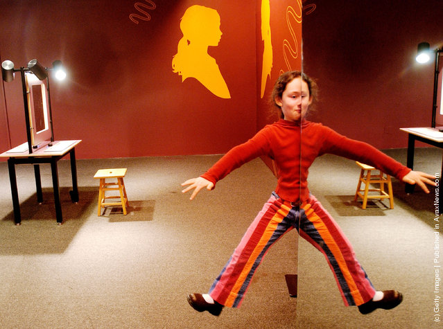 Hannah Pasternak, a student at Smith Elementary School in Tenafly, New Jersey appears to hover in space by using a combination of mirrors  January 29, 2004 at The American Museum of Natural History in New York City