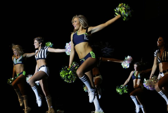 Seattle Seahawks Sea Gals cheerleaders perform at the Seattle Seahawks NFL football draft party, Thursday, May 8, 2014 at the CenturyLink Field Events Center in Seattle. (Photo by Ted S. Warren/AP Photo)