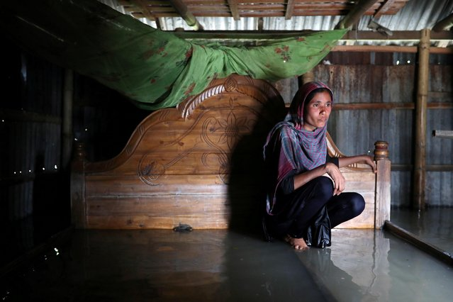 Shilpi, a flood-affected woman poses for a picture inside her flooded house in Jamalpur, Bangladesh, July 21, 2019. (Photo by Mohammad Ponir Hossain/Reuters)