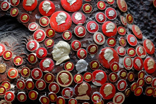 Badges of late Chinese chairman Mao Zedong are attached to a sculpture of Mao at Jianchuan Museum Cluster in Anren, Sichuan Province, China, May 13, 2016. (Photo by Kim Kyung-Hoon/Reuters)
