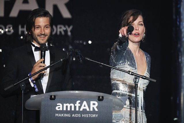 Diego Luna and Milla Jovovich appear on stage at the amfAR's 23rd Cinema Against AIDS Gala at Hotel du Cap-Eden-Roc on May 19, 2016 in Cap d'Antibes, France. (Photo by Andreas Rentz/Getty Images)