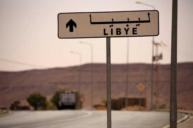 A road sign shows the direction of Libya near the border crossing at Dhiba, Tunisia April 11, 2016. (Photo by Zohra Bensemra/Reuters)
