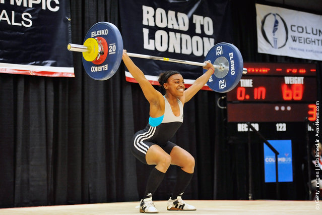 Jacque Payne successfully snatches 68 kilograms during the 2012 U.S. Olympic Team Trials for Women's Weightlifting