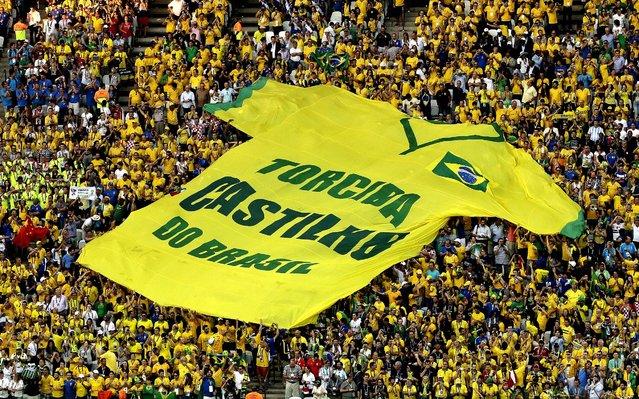 A giant shirt is displayed during the match between Brazil and Croatia in the Itaquerao Stadium in Sao Paulo. (Photo by Shuji Kajiyama/Associated Press)