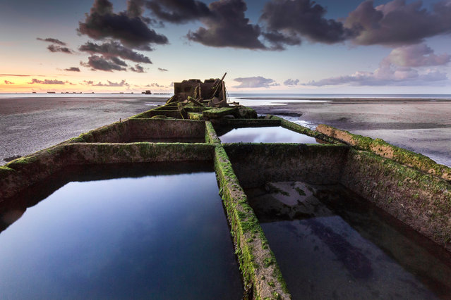 Overall winner: Mulberry Harbour in Arromanches, France by Stéphane Hurel. (Photo by Stéphane Hurel/Historic Photographer of the Year Awards 2019/The Guardian)