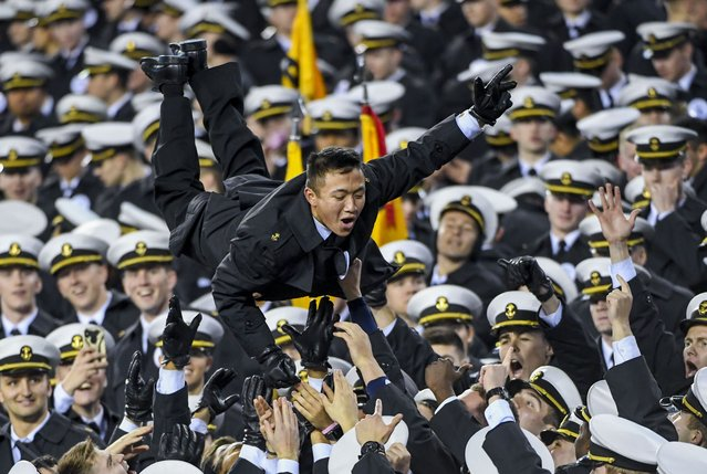 Navy midshipmen celebrate a Navy touchdown during the second half of an NCAA college football game, Saturday, December 14, 2019, in Philadelphia. Navy won 31-7. (Photo by Jonathan Newton/The Washington Post)