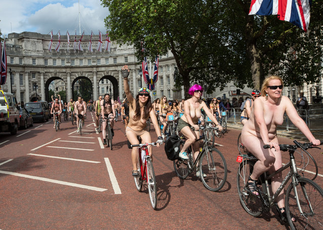 Naked bike ride 2014 on the Mall stretch of the London event, Britain, 14 June 2014. (Photo by Mario Mitsis/WENN.com)