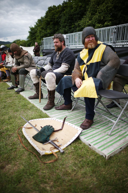 Re-enactors take a break during rehearsal for the Battle of Bannockburn Live event on June 27, 2014 in Stirling, Scotland. The 700th anniversary of the historic battle that saw outnumbered Scots army conquer the English led by Edward II in the First War of Scottish Independence. (Photo by Peter Macdiarmid/Getty Images)