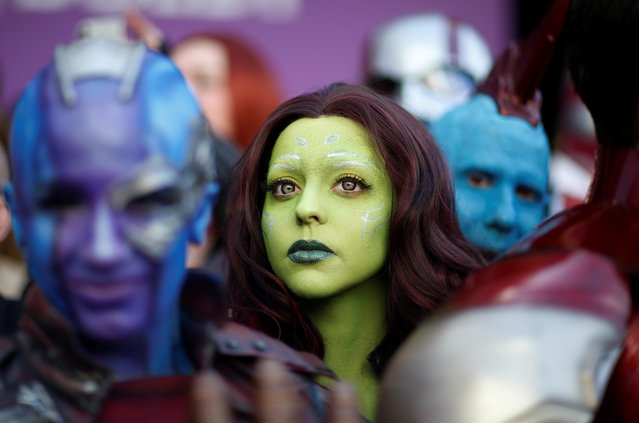 "Fans dressed up in costume await the cast members on the red carpet at the world premiere of the film ""The Avengers: Endgame"" in Los Angeles, California, April 22, 2019. (Photo by Mario Anzuoni/Reuters)"