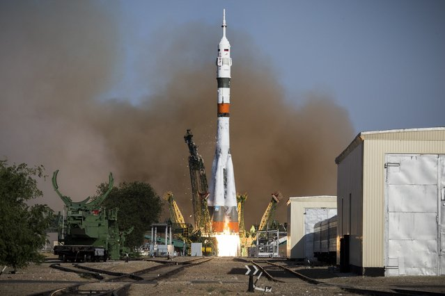 In this photo taken on Thursday, August 22, 2019, and distributed by Roscosmos Space Agency Press Service, the Russian Progress 73 cargo ship blasts off from the launch pad at Russia's space facility in Baikonur, Kazakhstan. The new Russian rocket, that is expected to replace the current model sending manned missions into space, blasted off from Kazakhstan on Thursday, carrying a Soyuz capsule with a humanoid robot. (Photo by Roscosmos Space Agency Press Service via AP Photo)