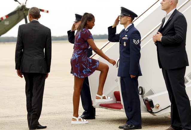 U.S. President Barack Obama waits as his daughter Sasha boards Air Force One, as they depart from Joint Base Andrews in Washington August 7, 2015. The Obamas are traveling to Martha's Vineyard in Massachusetts where they will enjoy a two-week vacation. (Photo by Kevin Lamarque/Reuters)