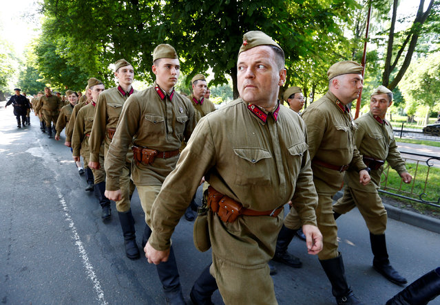 Military enthusiasts dressed as World War Two Red Army soldiers march as they mark the 75th anniversary of the Nazi Germany invasion, in Brest, Belarus, June 21, 2016. (Photo by Vasily Fedosenko/Reuters)