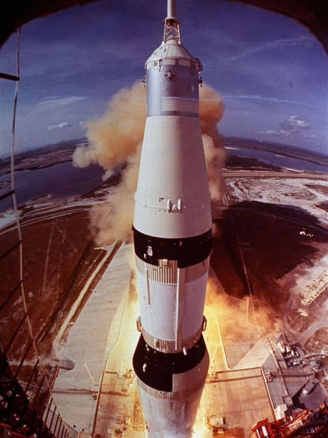 In this July 16, 1969 file photo provided by NASA, the Saturn V rocket that launched Neil Armstrong, Buzz Aldrin and Michael Collins on their Apollo 11 moon mission lifts off at Cape Kennedy, Fla. For the 45th anniversary of the Apollo 11 mission, Aldrin asked everyone to remember where they were when he and Armstrong became the first humans to step onto another heavenly body, and to share their memories online. (Photo by AP Photo/NASA)