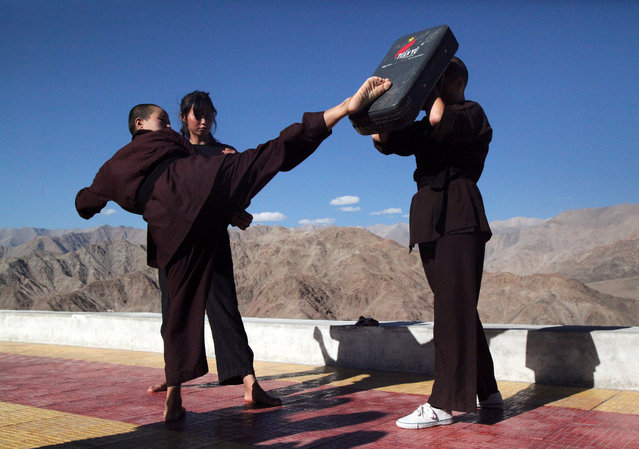 Buddhist nuns help a participant learn Kung Fu, a form of martial art, during a five-day workshop in Hemis region in Ladakh, India, August 17, 2017. (Photo by Nita Bhalla/Reuters)