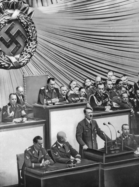 The Nazi invasion of  Poland and the start of World War II were just a few hours old when Fuehrer Adolf Hitler went before the Reichstag in Berlin on September 1, 1939, to deliver a war tirade without a formal declaration of war. From left are: Julius Schaub, SS leader and Hitler's personal adjutant; Dr. Hans Lammers, chief of Reich Chancellery; and press chief  Dr. Otter Dietrich.   Behind Hitler is Herman Goering, German Field Marshall.  (Photo by AP Photo)
