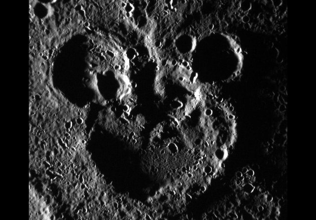 "MESSENGER, NASA's spacecraft orbiting Mercury, captured this June 03, 2012 scene near the recently named crater Magritte. Shadowing helps define a striking ""Mickey Mouse"" resemblance, created by the accumulation of craters over Mercury's long geologic history. (Photo by NASA/Johns Hopkins University Applied Physics Laboratory/Carnegie Institution of Washington)"