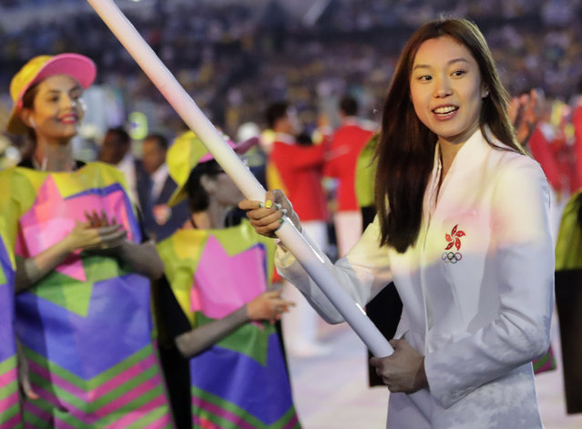 Stephanie Au carries the flag of Hong Kong during the opening ceremony for the 2016 Summer Olympics in Rio de Janeiro, Brazil, Friday, August 5, 2016. (Photo by David Goldman/AP Photo)