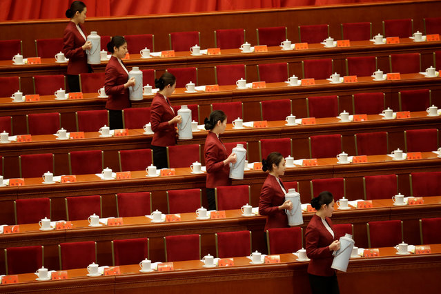 Attendants prepare tea inside the Great Hall of the People before the opening of the 19th National Congress of the Communist Party of China at the Great Hall of the People in Beijing, China October 18, 2017. (Photo by Jason Lee/Reuters)